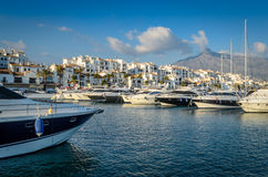 Yachts mooring in Puerto Banus, Marbella. Yachts moored at Puerto Banus, Marbella - Spain with La Concha in the background Stock Photos