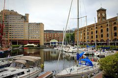 Yachts mooring St. Katharine Docks Marina London England. Boats moored in St Katharine DockSt Katharine Docks, in the London Borough of Tower Hamlets, were one Royalty Free Stock Image