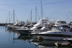 Yachts and motor boats moored at marina. Nelson Ba Stock Photos