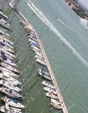 Yachts and motor boats moored in the prestigious tourist Harbour Stock Photos