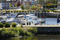 Yachts and motorboats at the jetty stock image