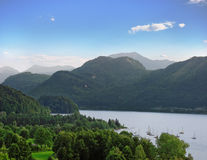 Yachts on mountain lake. Lake Attersee in Austria in sunny day Royalty Free Stock Photo