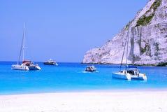 Yachts in Navagio Bay - Zakynthos. Navagio, wreck Bay on Zakynthos Island (Zante) in Greece. Blue sea, catamaran, yachts and white sandy beach Stock Photos