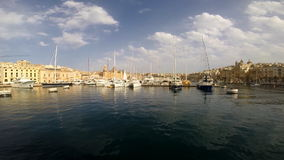 Yachts near pier in Birgu. Near Cospicua in Malta stock footage