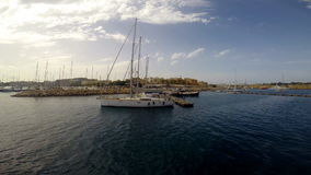 Yachts near pier in Birgu. Near Cospicua in Malta stock video footage