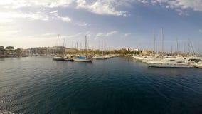 Yachts near pier in Birgu stock video footage