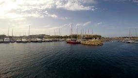 Yachts near pier in Birgu stock footage