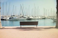 Yachts near the shore in the port, the city of Alicante. Spain Royalty Free Stock Photography