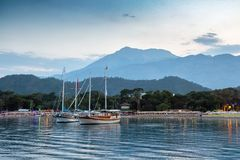 Yachts near the shore of the resort city in the evening Stock Photos