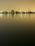 Yachts at night 1. Yachts mooring at night on still water with clear reflection and lots of negative space below. Taken in Williamstown, Australia, but could be Royalty Free Stock Image