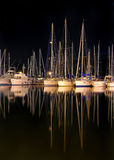 Yachts at night. Reflections of yachts in still water Stock Photos