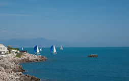 Yachts off Riviera coast. Royalty Free Stock Image