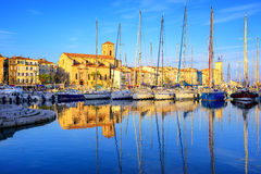 Yachts in old town port of La Ciotat, Marseilles, France. Yachts reflecting in blue water in the old town port of La Ciotat, Marseilles district, France, in the Royalty Free Stock Photos