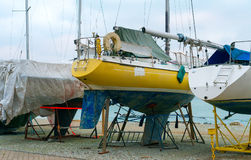 Yachts parked. Yachts parked on the beach in the off-season royalty free stock photo