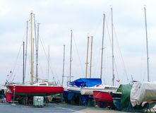 Yachts parked. Yachts parked on the beach in the off-season royalty free stock photography