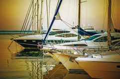 Yachts parked on mooring. In evening sunset Stock Photography