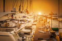 Yachts parked on mooring. In evening sunset Stock Images