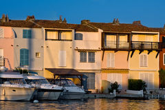 Yachts parking by house Royalty Free Stock Photo