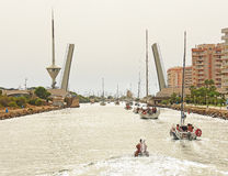 Yachts Passing under a Bridge Royalty Free Stock Image