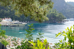 Yachts at the pier and beach on Mediterranean turkish resort Stock Photo