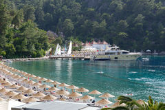 Yachts at the pier and beach on Mediterranean turkish resort Stock Images