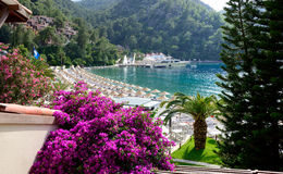 Yachts at the pier and beach on Mediterranean turkish resort Stock Image