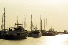 Yachts and pier at dusk Royalty Free Stock Image