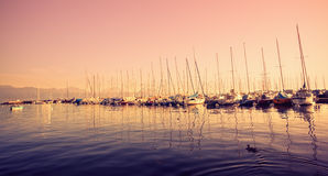 Yachts at the pier in dusk Stock Image