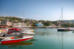 Yachts and pleasure boats are moored in marina Stock Photos