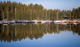 Yachts and pleasure boats in small marina Royalty Free Stock Photography