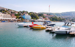 Yachts and pleasure motor boats are moored in marina Royalty Free Stock Photo
