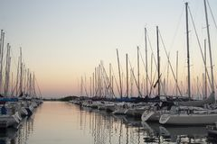 Yachts in a port at dusk stock image