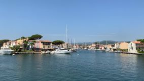Yachts in the port of Grimaud. Yachts and buildings in the port of Grimaud France stock video