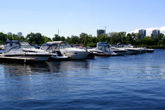 Yachts in the port. Motor yacht. Motorboat on the dock Stock Image