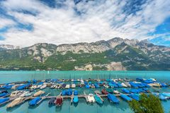 Yachts port on a mountain lake in the Alps, Switzerland Royalty Free Stock Image