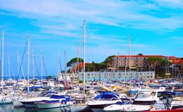 Yachts in port of Saint-Jean-Cap-Ferrat - resort and commune in southeast of France on promontory of Cote d`Azur in Provence-Alpe. S-Cote d`Azur region stock images