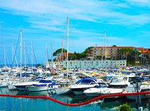 Yachts in port of Saint-Jean-Cap-Ferrat - resort and commune in southeast of France on promontory of Cote d`Azur in Provence-Alpe. S-Cote d`Azur region royalty free stock image