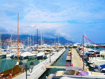 Yachts in port of Saint-Jean-Cap-Ferrat - resort and commune in southeast of France on promontory of Cote d`Azur in Provence-Alpe Royalty Free Stock Photo