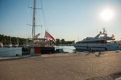 Yachts in the port at sunset, British boats on the pier stock photography