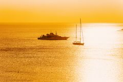Yachts on Porto Rotondo at sunrise. In the Mediterranean Sea in Costa Smeralda in Sardinia in Italy royalty free stock photo