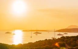 Yachts in Porto Rotondo at sunrise in Mediterranean Sea in Costa Smeralda, in Sardinia in Italy. Yachts in Porto Rotondo at sunrise in the Mediterranean Sea in royalty free stock photos