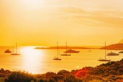 Yachts at Porto Rotondo at sunrise Mediterranean Sea Sardinia It. Yachts at Porto Rotondo at sunrise in the Mediterranean Sea in Costa Smeralda in Sardinia in stock photos