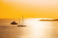 Yachts in Porto Rotondo sunrise Mediterranean Sea Sardinia Italy. Yachts in Porto Rotondo at sunrise at the Mediterranean Sea in Costa Smeralda in Sardinia in royalty free stock photos