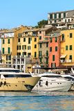 Yachts in Porto Venere - Liguria Italy. Luxurious yachts in the port of Porto Venere or Portovenere UNESCO world heritage site, seen from the Golfo dei Poeti Royalty Free Stock Images