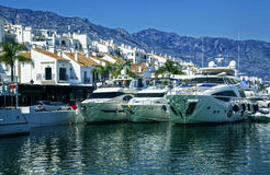 Yachts in Puerto Banus, marina of Marbella, Spain. Luxury yachts in Puerto Banus, the marina of Marbella, Spain Royalty Free Stock Photos