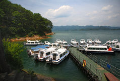 Yachts in Qiandao Lake. Qiandao Lake (also called thousand islands lake) is a man-made lake located in Zhejiang, China. It is a resort famous for its water and Royalty Free Stock Images
