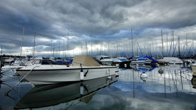 Yachts. On the quay. Lake Geneva. Early autumn. Cool and cloudy evening in Geneva. Switzerland Stock Photo