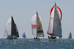Yachts race at Malaga, Spain. Yachts racing in the Mediterranean sea, at Malaga in Spain, April 2007. At least 60 yachts toke part in the race VI Regata Ciudad Stock Images