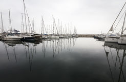 Yachts reflection in a row Royalty Free Stock Photography