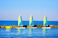 Yachts for rent near pier. Mediterranean Sea coast of Paphos, Cyprus Royalty Free Stock Photo